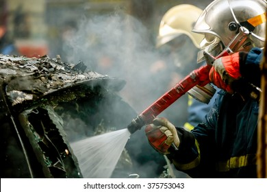 Athens, Greece - February 4, 2016: Firemen fighting a flaming car after an explosion