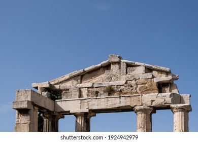 Athens Greece. Gate of Athena Archegetis, the Leader, at Roman Agora, Marble propylon with four Doric columns under Acropolis hill and Greek blue sky background, archaeological tourism