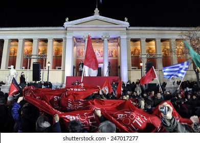 Athens, Greece Jan. 25, 2015. Supporters of Alexis Tsipras leader of Syriza left-wing party wave a giant flag outside Athens University. Syriza, won Sunday's general election.