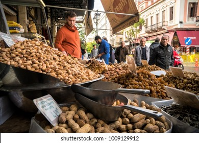 Athens, Greece - January 13, 2018: People buy nuts on the street market