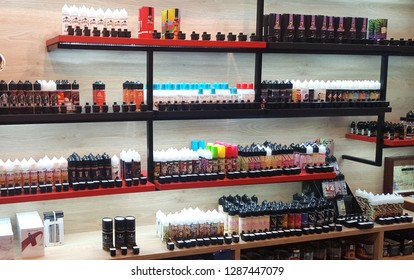 ATHENS, GREECE - JANUARY 16, 2019: Electronic cigarette liquids displayed in a store for sale