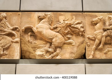 ATHENS, GREECE - JANUARY 28, 2011: West frieze entablature No. 8 (VIII) regarded as an original work of Pheidias himself, on the 3rd level of the New Acropolis Museum at night with no people