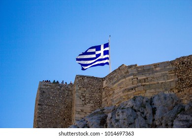 Athens, Greece, January 30 2018 - A gigantic Greek flag waving on the Acropolis hill.