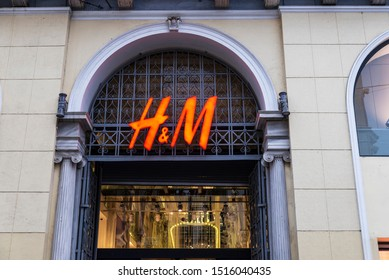 Athens, Greece - January 4, 2019: Display of a HM store at night in Athens, Greece