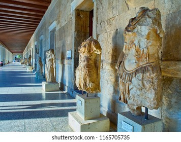 Athens, Greece - July 1, 2018. Sculptures of of the personification of Odyssey (left) and personification of the Iliad (right ) in the porch of the Stoa of Attalos building at the Agora of Athens.