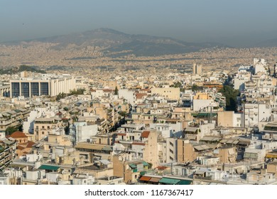 Athens, Greece, July 13th, 2017: Aerial view of cityscape with high skyline of Athens in a sunny day