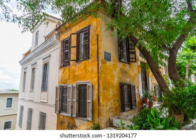 Athens, Greece - July 20, 2018: Streets and classic buildings in Plaka district of Athens, Greece. Plaka is a popular area full of restaurants, cafes and bars.