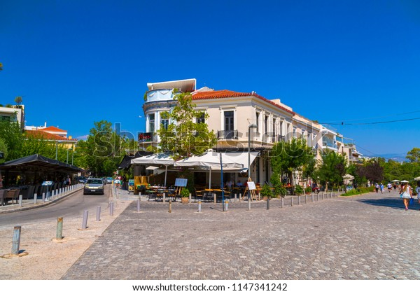 Athens, Greece - July 21, 2018: Streets and classic buildings in Plaka district of Athens, Greece. Plaka is a popular area full of restaurants, cafes and bars.