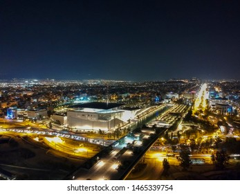 Athens, Greece - July 24: Aerial cityscape view of southern Athens at night. Centered the Foundation of Stavros Niarchos, SNFCC, culture center architecture design, Athens, Greece
