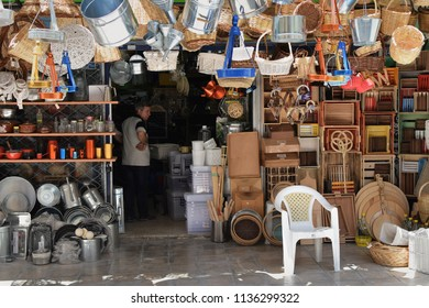 ATHENS, GREECE - JULY 4, 2018: Man in traditional housewares store in downtown Athens.