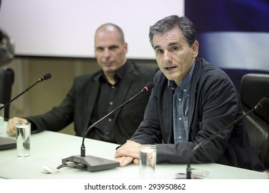 ATHENS, GREECE - JULY 6, 2015: Outgoing Greek Finance Minister Yanis Varoufakis (L) speaks as the new Finance Minister Euclid Tsakalotos (R) listens to him during a hand over ceremony