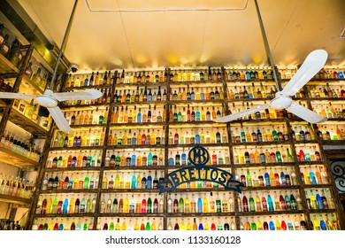 Athens, Greece -Jun 11, 2016: Shalf in yellow color light with rows of drink bottles in caffe Brettos on Jul 11, 2016 in Athens, Greeece.