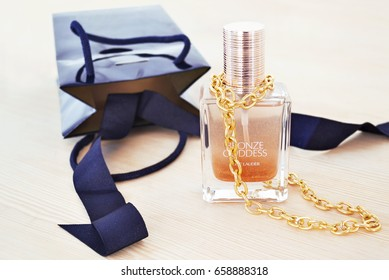 ATHENS GREECE, JUNE 05 2017: still life photography of Estee Lauder cosmetics with gold chain necklace. Editorial use.