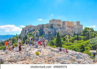Athens, Greece - June 12, 2017: Tourists visit the Areopagus, a prominent rock with mythological associations in Athens, Greece