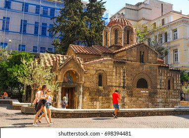 Athens, Greece - June 13, 2017: Tourists visit the Agios Eleftherios Church in Athens, Greece