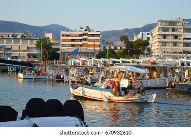ATHENS, GREECE - JUNE 14: Fisherman coming back in Glyfada, Athens, Greece on June 14, 2017.