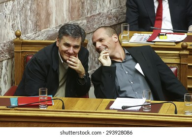 ATHENS, GREECE - JUNE 16, 2015: The new finance minister of Greece Euclid Tsakalotos (L) and the Former Minister of Finance Yanis Varoufakis (R) at the Parliament