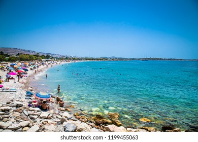 ATHENS, GREECE - JUNE 19, 2016: People on the Glyfada beach in Athens, Greece .
