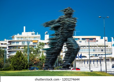 ATHENS, GREECE - JUNE 20. 2016:: Dromeas sculpture in Athens, Greece. Created by noted sculptor Kostas Varotsos in 1994, is a 12 meter tall glass and iron sculpture.