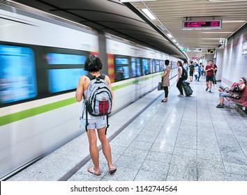 Athens, Greece - June 29, 2018. Tourists waiting for a train in a Athens Metro station.