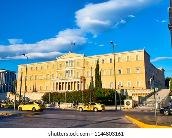 Athens, Greece - June 29, 2018. Principal facade of The Old Royal Palace, Greek Parliament building, at sunset. View from Leoforos Vasilisis Amalias Avenue, Syntagma Square, Athens.