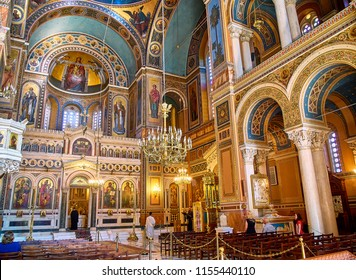 Athens, Greece - June 30, 2018. Orthodox priests celebrating the Divine Liturgy in the Metropolitan Cathedral of the Annunciation, also known as the Mitropoli or Metropolis. Athens, Attica, Greece.