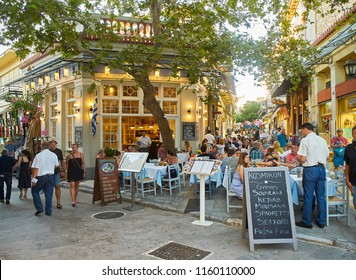 Athens, Greece - June 30, 2018. A terrace of a Greek restaurant at Plaka neighborhood of Athens city, offering typical Greek food on a blackboard. Attica region, Greece.