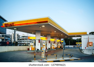 Athens, Greece - Mar 28, 2016: Empty Modern Shell gas station illuminated at dusk in on of the neighborhoods of Athens near the port