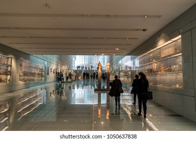 ATHENS, GREECE - MARCH 06, 2018: Visitors at the New Acropolis Museum in Athens. Designed by the Swiss-French Architect Bernard Tschumi.