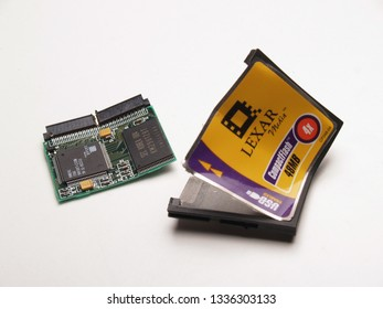 ATHENS, GREECE – MARCH 11 2006: Damaged and opened up Lexar 48MB CompactFlash memory card, isolated on white background