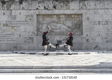 ATHENS, GREECE - MARCH 25: Evzones (presidential ceremonial guards) guarding the Tomb of the Unknown Soldier at the Hellenic Parliament Building, March 25, 2011 in Athens, Greece.