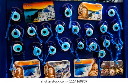 ATHENS, GREECE - MARCH 5, 2018 Greek Ceramic Designs Evil Eye Magnets, Parthenon Athens Greece. Evil eye is a curse in the form of a stare.  Evil eye symbols are a defense against curses