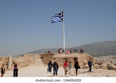 ATHENS, GREECE - MAY 13, 2016: People stand on the viewing platform at the Acropolis of Athens. The site is one of the top tourist attractions in the World.