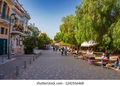 ATHENS, GREECE - MAY 2016: Crowds of people walking on the pedestrian Dionysiou Areopagitou Street. Its the longest walkway in Athens and will seamlessly integrate you into a living open-air museum.