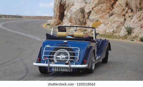 ATHENS, GREECE, MAY 27, 2018. Rear view of classic car MORGAN +4, made in England in 1968, during the classic climb of Mount Parnes, close to Athens, Greece.