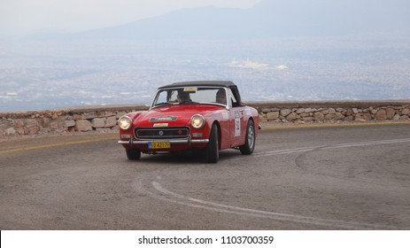 ATHENS, GREECE, MAY 27, 2018. Classic car MG MIDGET, made in England in 1972, during the classic climb of Mount Parnes, close to Athens, Greece.