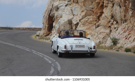 ATHENS, GREECE, MAY 27, 2018. Rear view of classic car Mercedes-Benz 190SL, made in Germany in 1958, during the classic climb of Mount Parnes, close to Athens, Greece.
