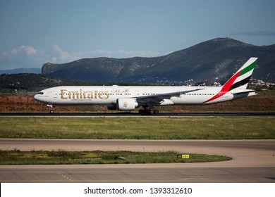 """Athens, Greece - May 7, 2019. An Emirates Boeing 777-300 (A6-ECM) takes off from Athens International Airport """"Eleftherios Venizelos""""."""