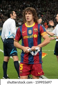 ATHENS, GREECE - NOV 24 : Carles Puyol of Barcelona holding the team flag before the UEFA Champions League group stage match Panathinaikos vs Barcelona on November 24, 2010 in Athens, Greece
