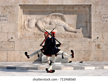 "ATHENS, GREECE - November 1, 2010.  Changing of the presidential guard (the so-called ""Evzones"") in front of the Monument of the Unknown Soldier, next to the Greek Parliament, Syntagma square."
