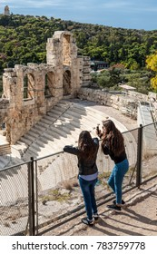 Athens, Greece - November 1, 2017: Tourists visit the Acropolis of Athens, an ancient citadel located on a rocky outcrop above the city and famous landmark in Athens, Greece.