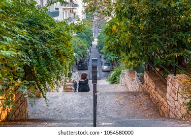 Athens / Greece - November 14, 2015: A young boy and a young girl romancing in the neighbourhood  of Kolonaki, under mount Lycabettus.