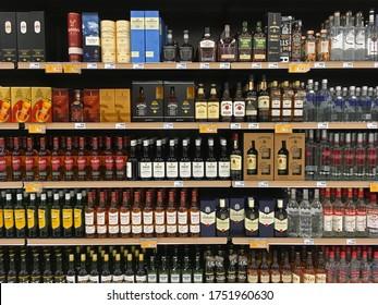 Athens, Greece - November 14, 2019: Whisky and vodka alcoholic drink beverage bottles on display at liquor store.