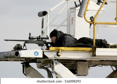 Athens, Greece, November 15, 2016: A sniper aims his weapon securing the area as President Barack Obama arrives at the Athens International Airport Eleftherios Venizelos