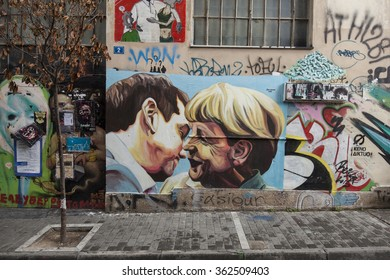 Athens, Greece - November 28, 2015: Graffiti with Greek PM Alexis Tsipras and German chancellor Angela Merkel on the wall in old town.