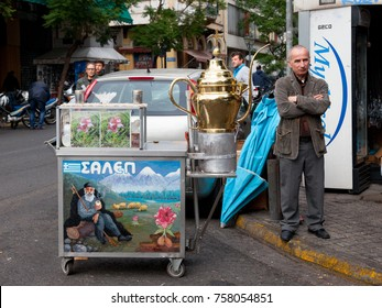 ATHENS, GREECE - NOVEMBER 4, 2017: Old man selling Salep from a cart. Salep is a typical drink from Greece and Turkey made of hibiscus flower