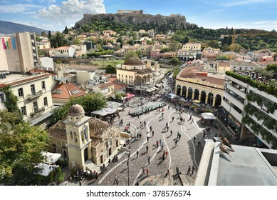 ATHENS, GREECE - OCT. 2015: Monastiraki square's aerial view. Located on Ermou Street, this is a flea market in the old city of Athens, Greece. The Acropolis is in the top background.