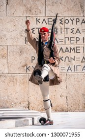 Athens, Greece - October 02, 2018: Changing of guards in front of the Tomb of the Unknown Soldier, located in front of the Greek Parliament Building on Syntagma Square