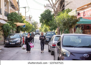 Athens, Greece - October 18, 2018: Stylish women friends shopping and running errands in the Gazi neighborhood, known for its trendy nightlife.