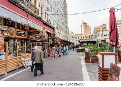 Athens, Greece - October 19, 2018: An older couple enjoys wandering the streets of the Psyri neighborhood, a popular area known for its nightlife and central market.